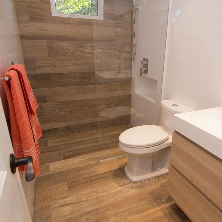 waterproof Hot Press Tiles LVT on the floor and wall in bathroom.jpg